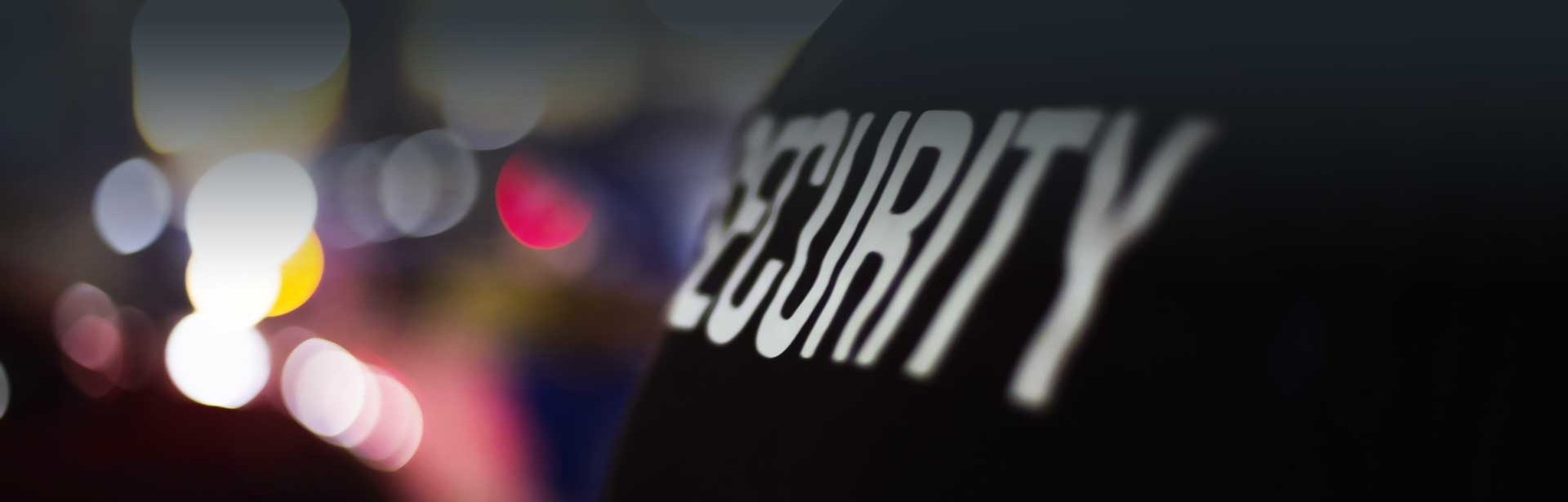 Stylized close up of a vest with 'Security' written upon it.